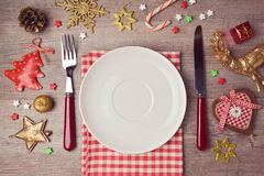 Christmas dinner background with rustic decorations. View from above royalty free stock image