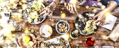Christmas dinner. Falling golden snowflakes. Cheers Top of view of a nicely served wooden table Christmas dinner with tasty dishes. Christmas dinner. Cheers Top Stock Photo