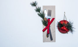 Christmas dinner fancy royal dinning white table. Christmas royal dinning with wooden table and pine tree Royalty Free Stock Photos