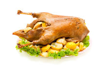 Christmas dinner goose baked with vegetables Stock Photos