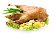 Christmas dinner goose baked with vegetables Royalty Free Stock Photos