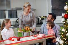 Christmas dinner, happy family at the table. Together Royalty Free Stock Photos