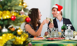Christmas dinner at home cheerful  family. Christmas dinner at home cheerful happy young family Stock Photo