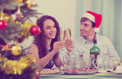 Christmas dinner at home young family. Christmas dinner at home positive young family Royalty Free Stock Photos