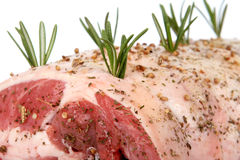Christmas dinner, joint of raw meat ready for cooking. Isolated on white, macro close up with copy space Royalty Free Stock Image