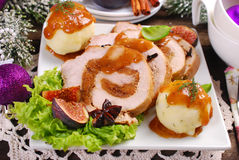 Christmas dinner with loin of pork stuffed with figs and potato Royalty Free Stock Image