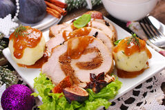 Christmas dinner with loin of pork stuffed with figs and potato Royalty Free Stock Photos