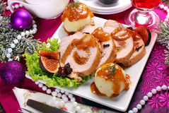 Christmas dinner with loin of pork stuffed with figs and potato Stock Photo