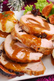 Christmas dinner with loin of pork stuffed with figs and potato Royalty Free Stock Photography