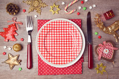 Christmas dinner plate setting with rustic decorations. View from above Royalty Free Stock Image
