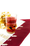 Christmas dinner with red candle. Celebrating Christmas at the dinner table with red candle and golden bow. Isolated on white royalty free stock photos