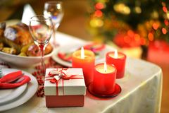 Christmas dinner. Rich table setting for Christmas dinner Royalty Free Stock Images