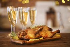 Christmas dinner with roast duck and champagne Stock Photos