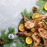 Christmas dinner with roasted meat steak, baked potato, grilled vegetables, cranberry sauce. royalty free stock photo