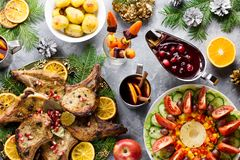 Christmas dinner with roasted meat steak, Christmas Wreath salad, baked potato, grilled vegetables, cranberry sauce royalty free stock images