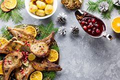Christmas dinner with roasted meat steak, Christmas Wreath salad, baked potato, grilled vegetables, cranberry sauce. Delicious Christmas meal with roasted meat stock image