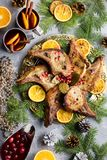 Christmas dinner with roasted meat steak, Christmas Wreath salad, baked potato, grilled vegetables, cranberry sauce. Delicious Christmas meal with roasted meat royalty free stock photography