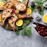 Christmas dinner with roasted meat steak, Christmas Wreath salad, baked potato, grilled vegetables, cranberry sauce. Delicious Christmas meal with roasted meat stock photos