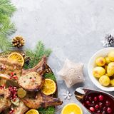 Christmas dinner with roasted meat steak, Christmas Wreath salad, baked potato, grilled vegetables, cranberry sauce. Delicious Christmas meal with roasted meat stock photography