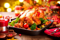 Christmas Dinner. Roasted turkey garnished with potato. Vegetables and cranberries stock images