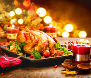 Christmas dinner. Roasted turkey. Winter holiday table. Decorated with candles Royalty Free Stock Images