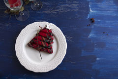 Christmas Dinner rustic, white plate, and napkin red boxes in th Stock Photo