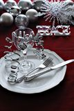 Christmas dinner setting. With silver, white and red stock images