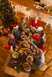 Christmas Dinner. Shot from above of a family sat down to have Christmas dinner. They are all raising a glass, toasting Stock Photography