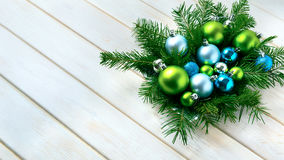 Christmas dinner table centerpiece with blue glitter ornaments Stock Photo