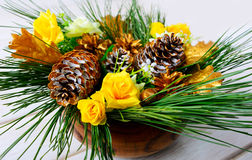 Christmas dinner table centerpiece with golden cones Stock Photos