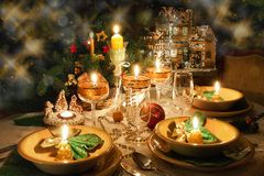 Christmas dinner table  with christmas mood. Christmas dinner table with candles with christmas atmosphere Royalty Free Stock Photography