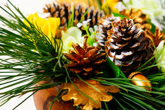 Christmas dinner table decoration with pine branches and golden Stock Photography
