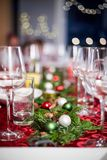 Christmas dinner table with decorations and glasses royalty free stock photo
