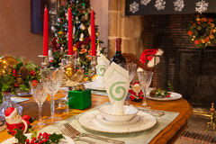 Christmas dinner table setting - warm ambiance Stock Photos