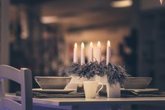 Christmas dinner table for two. Cozy warm table set with candles. Perfect romantic atmosphere. Concept for love holidays. Celebration Stock Photo