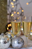 Christmas dinner with white wine. Silver Christmas balls a dinner with white wine as apetizerer stock image