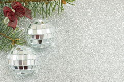 Christmas disco ball ornament and fir tree Stock Photos