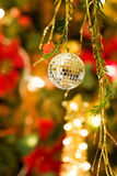 Christmas disco ball over defocused tree Stock Photography