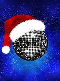Christmas disco ball with Santa hat Stock Images