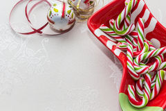 Christmas dish with candy canes. And christmas ornaments Stock Image