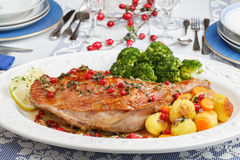 Christmas dish roasted turkey leg with gooseberries Stock Photos