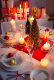 Christmas dishware on the white and red table Stock Photo