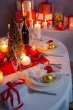 Christmas dishware on the white and red table Royalty Free Stock Photos