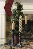 Christmas display in front of fireplace royalty free stock image