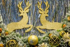 Christmas display. With golden reindeers and christmas tree decorated Royalty Free Stock Image