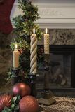 Christmas decorations in front of the fireplace stock photography