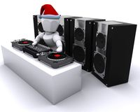Christmas DJ mixing records on turntables Stock Photos