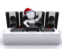Christmas DJ mixing records on turntables Royalty Free Stock Photo