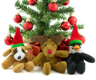 Christmas Dog Penguin and Reindeer. Cuddly christmas Dog Penguin and Reindeer with christmas tree and presents Stock Photography
