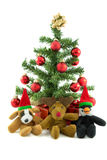 Christmas Dog Penguin and Reindeer. Cuddly christmas Dog Penguin and Reindeer with christmas tree and presents Stock Image